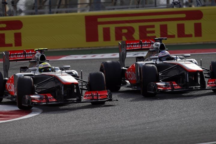 Pérez e Button com a problemática McLaren de 2013